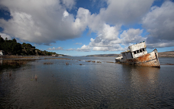 This battered boat is an icon in Inverness along Tomales Bay. Point Reyes boat in Inverness by Richard James, Creative Commons 2014