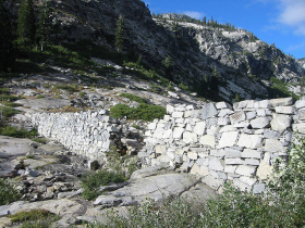Sometimes dams outlive their usefulness: dynamited early 1900s mining dam at Emerald Lake in the Trinity Alps