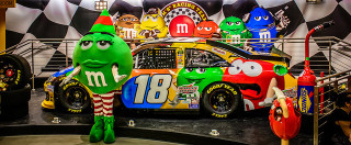 Good-humored spoofs of the hot babe-hot car connection have become a hot commodity. (photo of The M&M Race Car and M&M Girl by The JH Photography)