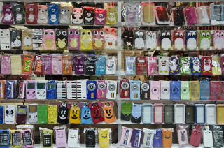 The initial image for this story, of cell phone covers for sale on New York's Canal Street, is by Eric Parker. Cell Phone Covers - D7K 2278 ep Canal Street, New York, 2012